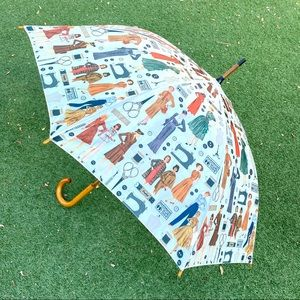 Vintage wooden-handle umbrella w/ sewing print